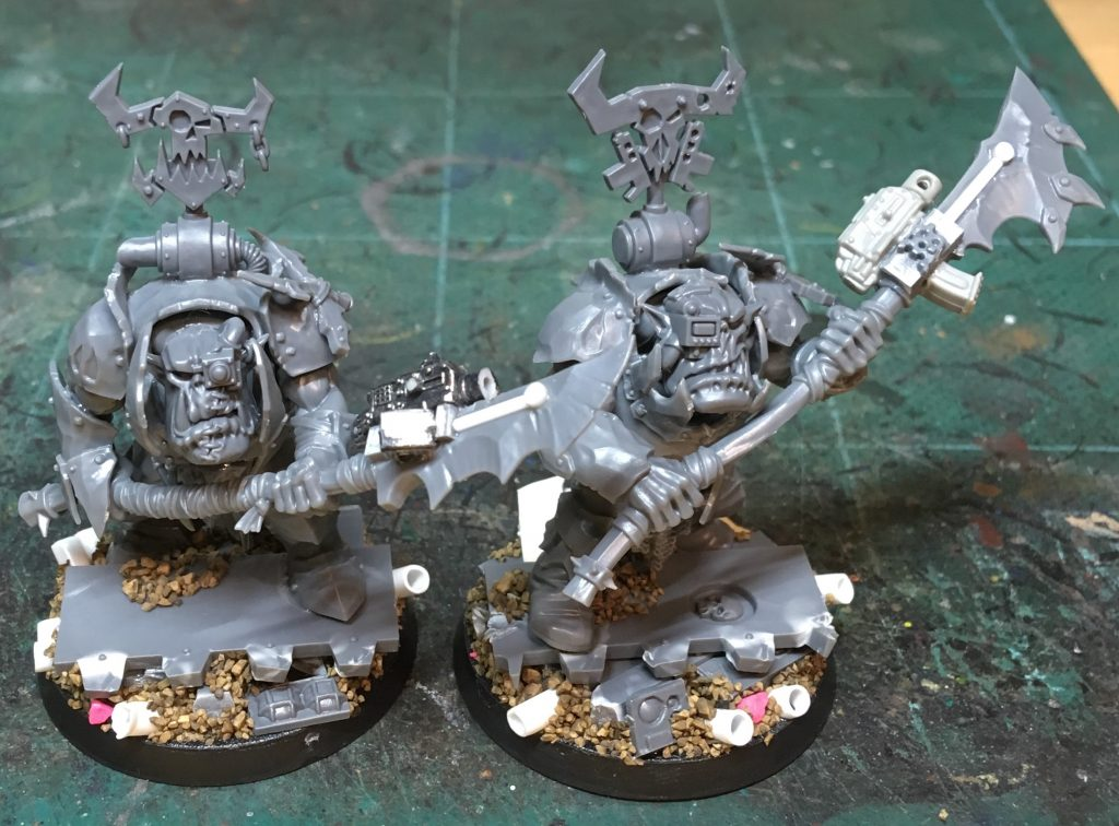 Two ork custodes models with more detail on the weapons